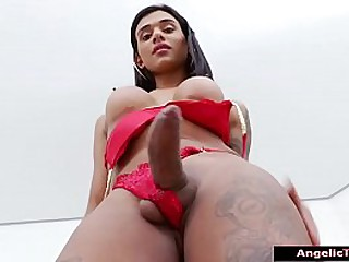 Busty shemale Julia Alves showing off her big tits and round ass in red lingerie.The latina tgirl makes her big cock hard and oils up and jerks it