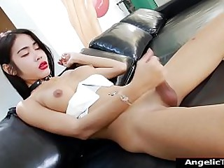 Busty Asian shemale Milk B showing off her big tits and hard uncut cock.She strips naked and jerks herself off and she spreads her ass until it gapes